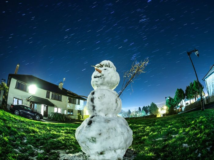 Snowman starring at the stars Astronomy Building Exterior Grass Illuminated Night No People Outdoors Sculpture Sky Snowman Snowman Snow Star - Space Starrails Stars Statue