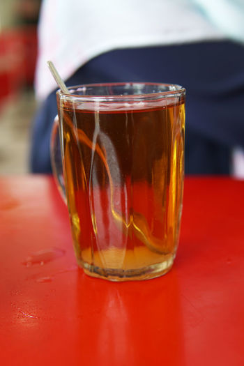 Close-up of tea in glass on table