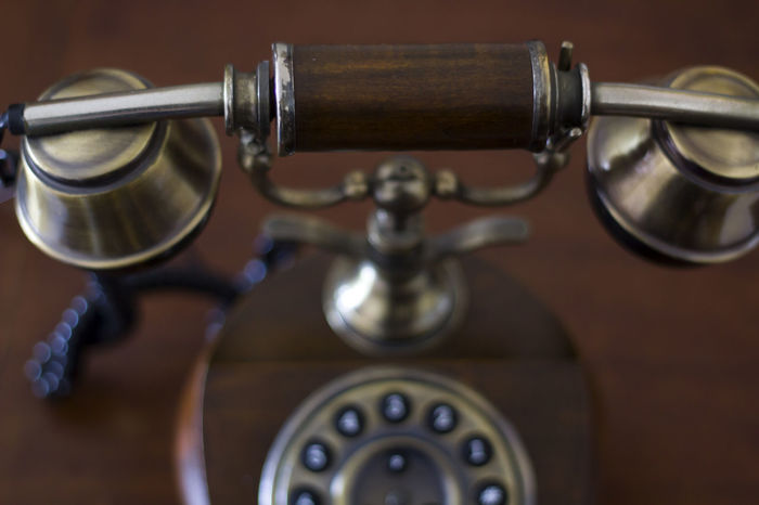 Vintage phone on wooden table. Top View Antiquated Antique Classic Retro Call Communication Connection Dial Handset Indoors  Landline Phone No People Number Old Old Telephone Phone Retro Styled Style Table Technology Telecommunications Equipment Telephone Vintage Wood - Material