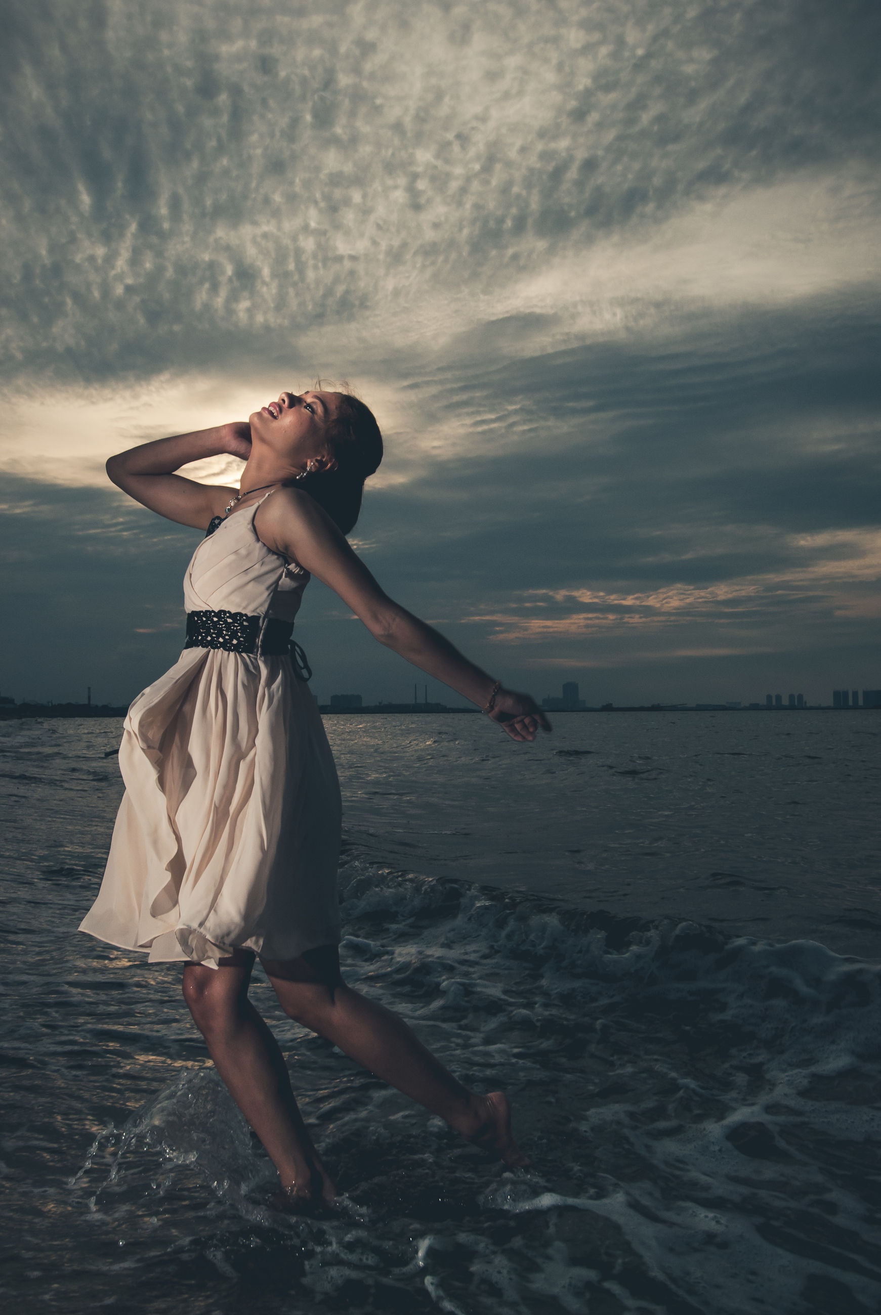 sea, water, one person, sky, cloud - sky, sunset, women, full length, young women, land, real people, young adult, fashion, lifestyles, beach, clothing, leisure activity, adult, beauty in nature, outdoors, horizon over water, beautiful woman, hairstyle