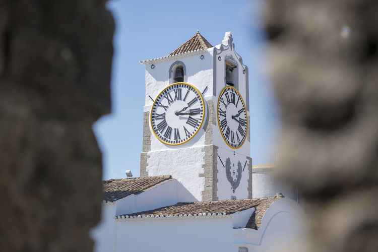 Low angle view of white clock tower