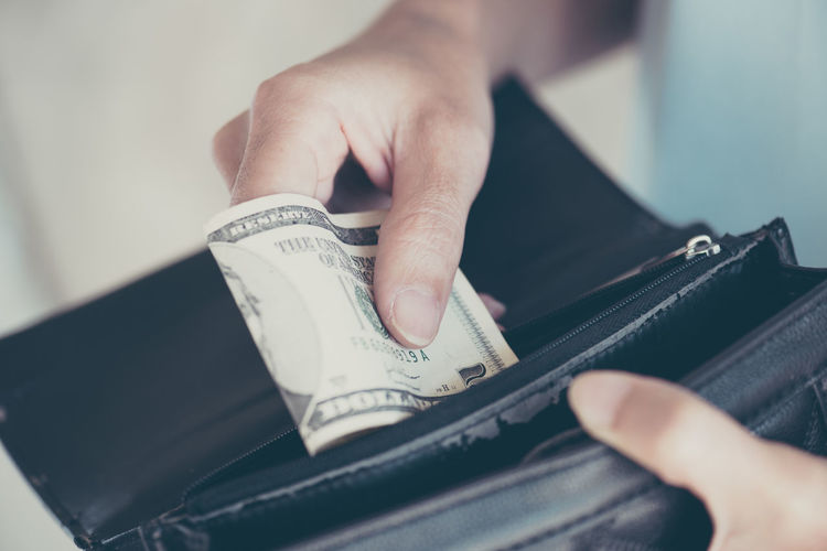 Hand Human Hand Human Body Part One Person Holding Real People Indoors  Selective Focus Body Part Close-up Wallet Finance Human Finger Finger Paper Currency Wealth Business Currency Unrecognizable Person Leather Consumerism Jeans