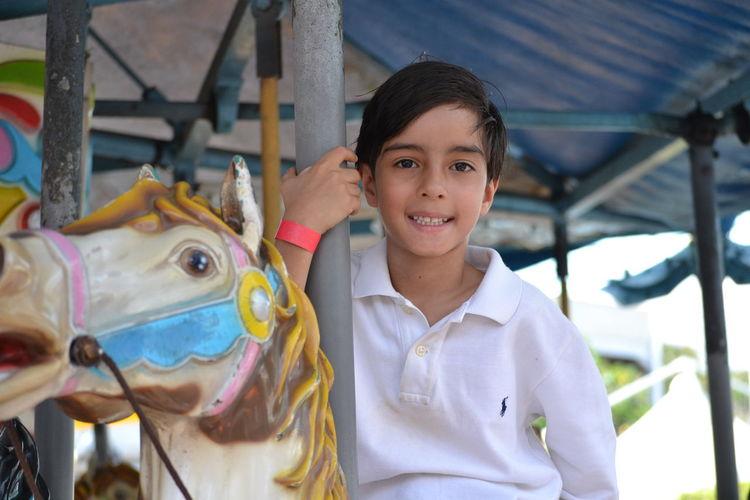 Portrait of boy at amusement park