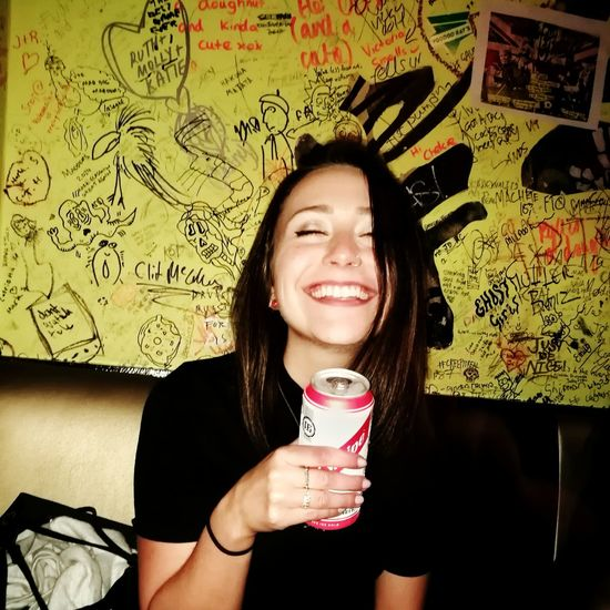 Only Women Smiling One Woman Only One Person Drinking Adult Enjoyment Portrait Fun Happy Hour Happiness Holding Laughing Girl Brunette Young Women Red Stripe Beer Beer Alcohol Graffiti Rock And Roll Rock Bar Rock Girl Hipster Smile The Portraitist - 2017 EyeEm Awards