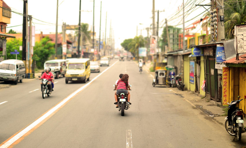 Riding in tandem, Calamba, Laguna, Philippines. Street Riding Transportation Drive Freedom Urban Road Motorcycles Streetphotography Street Photography Highway Riding In Tandem Urban Exploration Eyeem Philippines EyeEmNewHere Calamba, Laguna Philippines Adventures In The City