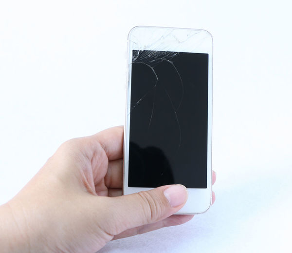 hand holding broken screen iPhone Human Hand Hand Human Body Part Technology Communication Body Part Wireless Technology Smart Phone Portable Information Device Connection Holding Finger Screen Close-up Touch Screen Copy Space People Human Finger Mobile Phone Breaking