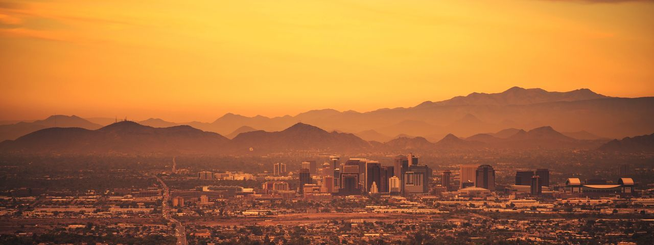 Phoenix Arizona Panoramic Photo. Sunset in the City. United States of America. Arizona Sunset_collection United States Architecture Beauty In Nature Building Exterior Built Structure City Cityscape Environment Fog Landscape Mountain Mountain Range Nature No People Orange Color Outdoors Phoenix Scenics - Nature Sky Sun Sunset Travel Destinations
