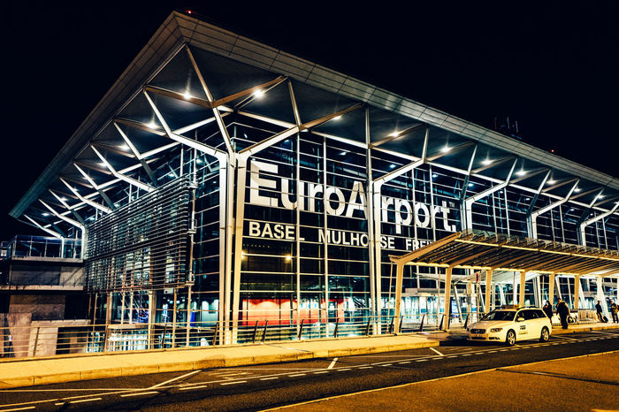 Airport Basel Architecture Basel Mulhouse Building Building Exterior Built Structure City Communication Illuminated Incidental People Information Sign Lighting Equipment Low Angle View Night No People Non-western Script Outdoors Railing Sign Street Text Western Script
