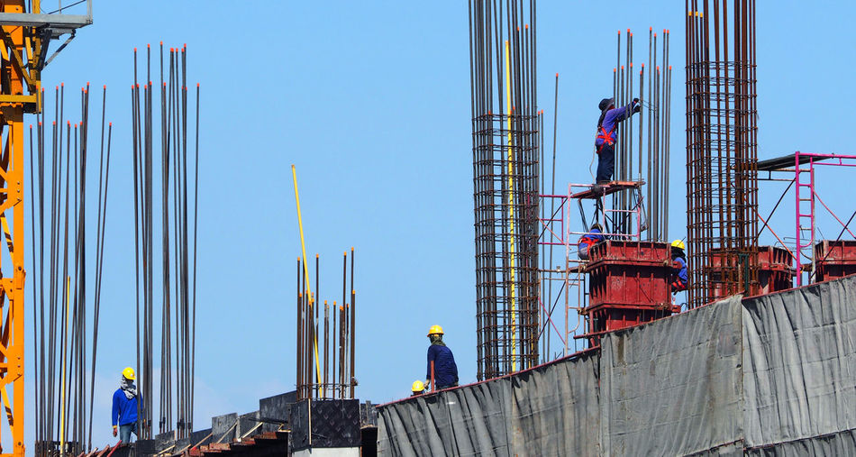 Man working at construction site against clear sky