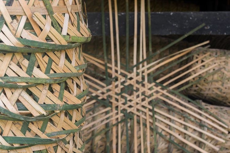 Close up of a stack of Indonesian traditional hand made hand woven bamboo baskets with part made one in the back ground. INDONESIA Indonesian Stack Abundance Bamboo Bamboo Basket Basket Close-up Craft Craftmanship Focus On Foreground Hand Made Hand Woven Large Group Of Objects Pile Stacked Traditional