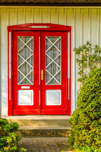 Red closed door of building