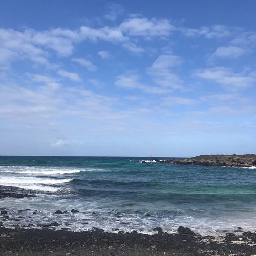 Sea Beach Sky Beauty In Nature Nature Scenics Wave Horizon Over Water Blue No People Water Tranquility Outdoors Tranquil Scene Cloud - Sky Day Travel Destinations Orzola. Lanzarote Playa Spiaggia
