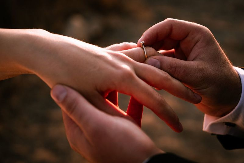 Close-up of couple holding hands