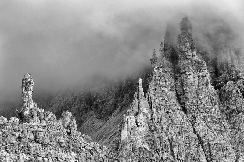 Low Angle View Of Rocky Mountains At Tre Cime Di Lavaredo During Foggy Weather