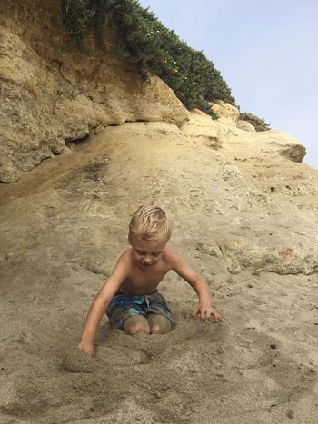 Full Length Leisure Activity Lifestyles Person Vacations Childhood Rock - Object Cute Elementary Age Playing Beach Summer Relaxation Casual Clothing Portrait Sand Sunny Cove Beach Live Oak Santa Cruz California Travel Destinations Weekend Activities Water