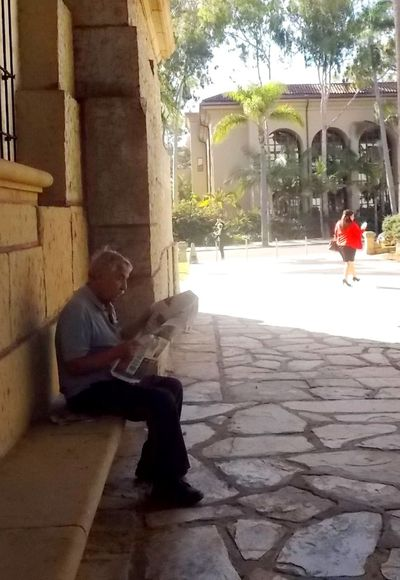 Reading a newspaper Leisure Activity People People In Shadow People Photography People Reading People Reading News People Reading Newspaper People Sitting People Watching Peoplephotography Portrait Portraits