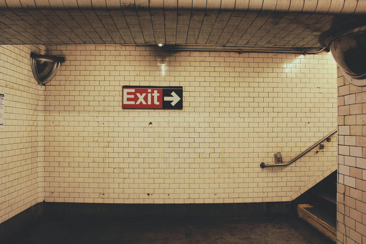 Exit Sign On Tile Wall In Subway Station
