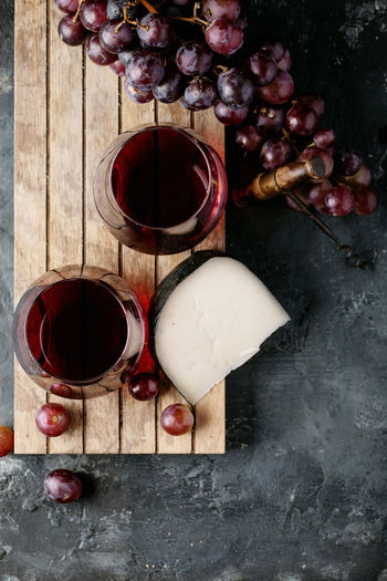 High angle view of red wine in glass on table