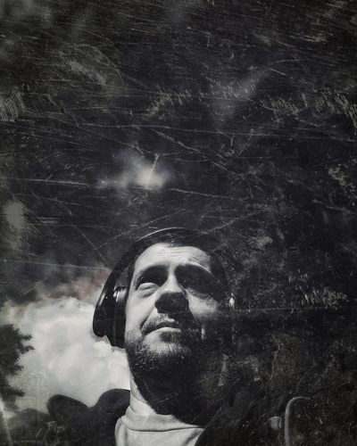 Close-up of mature man against bright sun