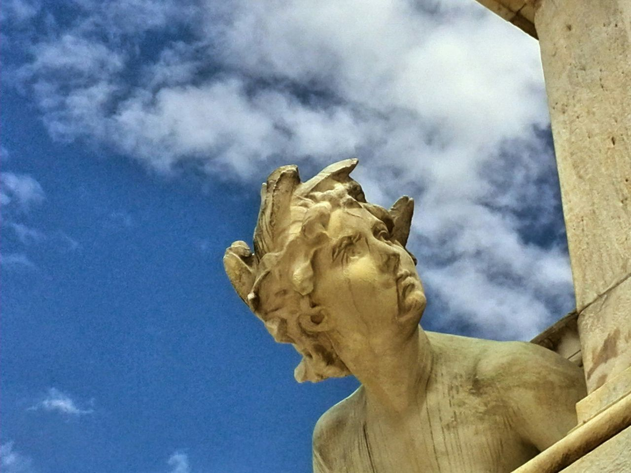 statue, sculpture, cloud - sky, sky, low angle view, art and craft, human representation, outdoors, day, no people