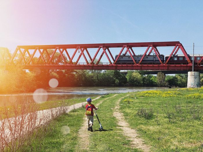 The explorer 🧭... Environment Backpack Hiking Hiker Exploring Tracks Summer Childhood Education Explore Adventure Scooter Child Public Transportation Train Train - Vehicle Built Structure Architecture Connection Bridge Bridge - Man Made Structure Nature Sky Transportation Travel Sunlight Clear Sky Lifestyles Engineering Water