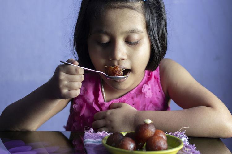 Portrait of girl child eating food