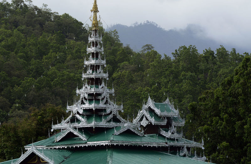 Low angle view of buddhist temple by tree