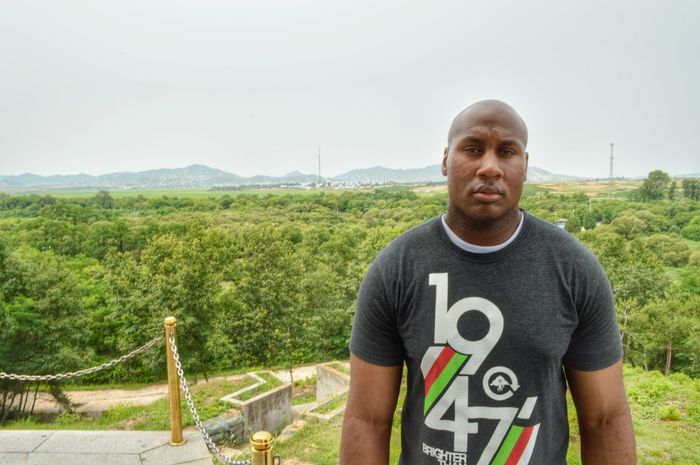 This was taken while i was at the DMZ. Behind me is a North Korea propaganda village. South Korea The View DPRK