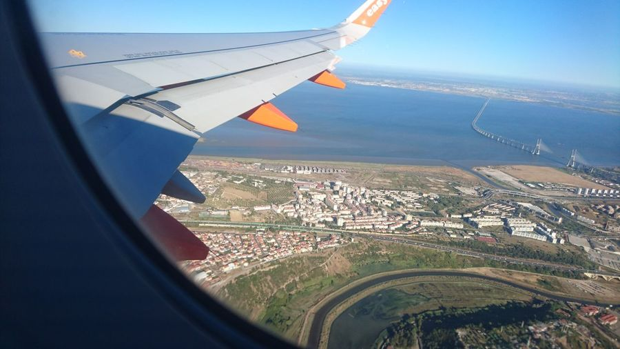 EyeEm Selects Aerial View Flying Airplane Air Vehicle Transportation Aircraft Wing Travel City Cityscape Outdoors Mid-air Sky Travel Destinations Aerospace Industry Landscape Day No People Portugal Portugal Is Beautiful Portugal_lovers Lissabon, Lisboa