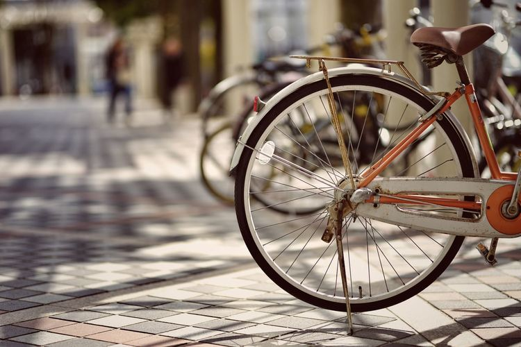 Close-up of bicycle wheel in city