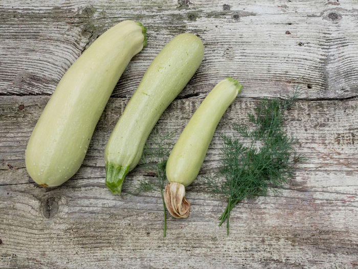 Fresh organic zucchini and dill on old vintage wooden background Close-up Day Food Food And Drink Freshness Green Color Healthy Eating High Angle View Indoors  No People Raw Food Still Life Table Vegetable Wood - Material Wooden Texture Zucchini