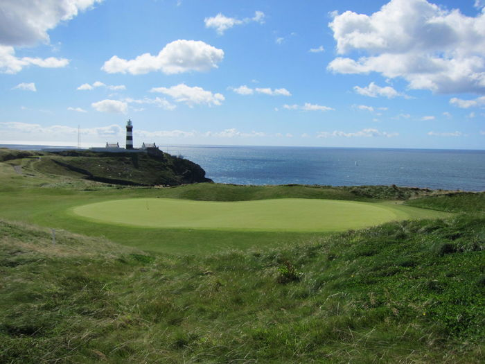 Golf Course By Sea Against Sky