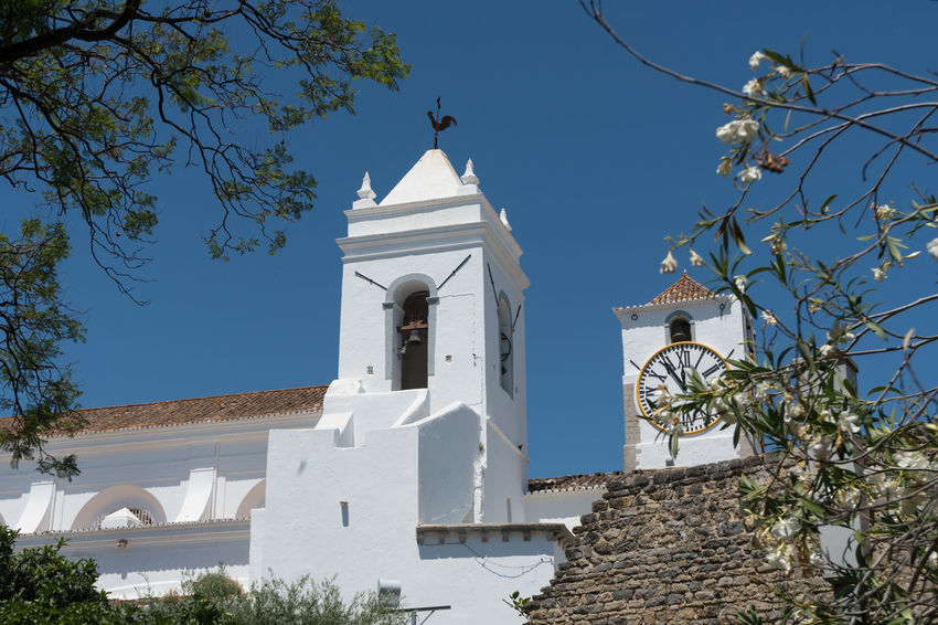 Tavira Old Town Architecture Belief Bell Tower - Tower Blue Building Building Exterior Built Structure Low Angle View Nature No People Outdoors Place Of Worship Plant Religion Sky Spirituality Tower Tree White Color