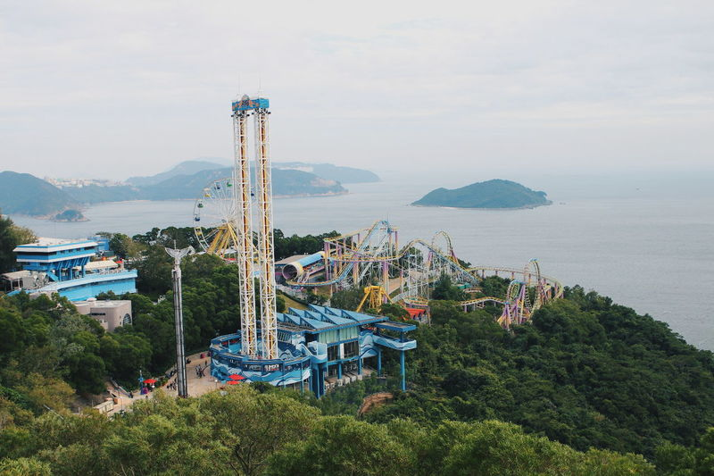 View of amusement park by sea