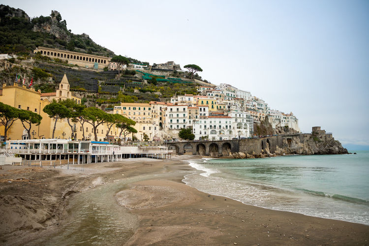 Italy Amalfi  Amalfi Coast Built Structure Architecture Water Building Exterior Building Sky Nature Land Beach Clear Sky Sea Day Travel Destinations City Tree No People Residential District Tourism Travel Outdoors