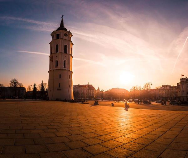 Bell tower in Cathedral Square in Vilnius, Lithuania Architecture Building Exterior Built Structure Building City Sunset Tower Travel Destinations Sunlight Street History Sun Place Of Worship Tourism Travel Lens Flare City Travel Landmark Europe East Europe Church Bell Tower Square Cathedral Vilnius Lithuania Old Town Capital Capital Cities  Centre Center Downtown