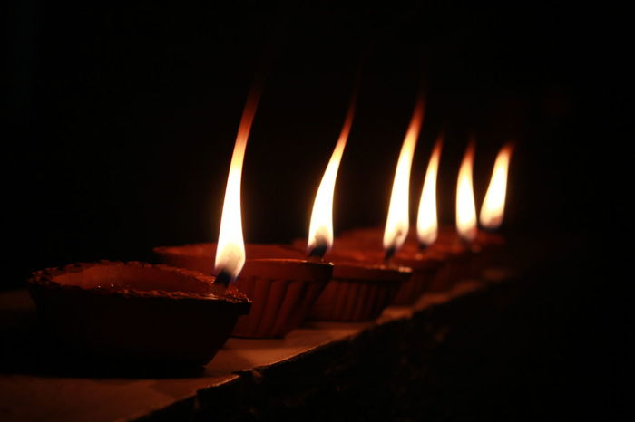 Hindu New Year starts with glowing conventional lamps. The festival is Deepawali which means series of lamps Abstract Arts Culture And Entertainment Black Background Burning Candle Dark Diwali Lamps Festival Lamps Fire Flame Glowing Handmade Lamps Heat - Temperature Ideas Illuminated Indoors  Lamps Lit Night
