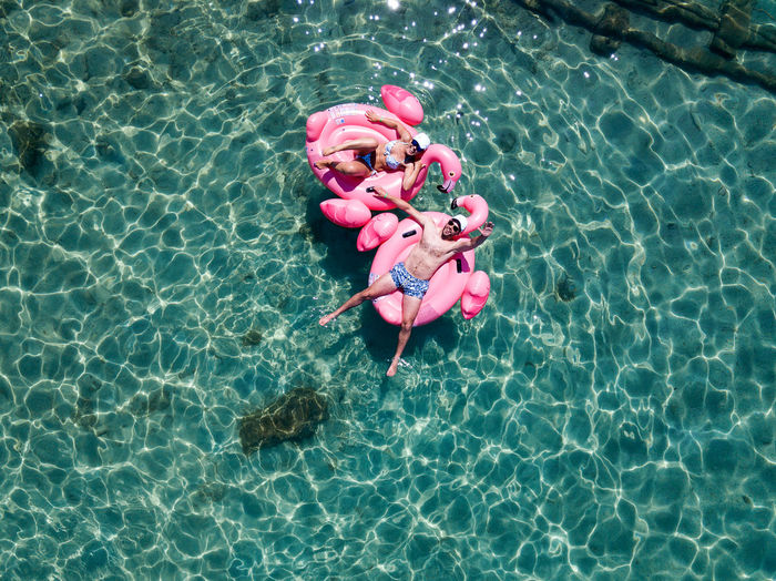 Couple enjoying Couple Drone  Enjoying The Sun Summertime Animal Day Dronephotography Enjoying Life Floating Floating On Water High Angle View Joy Nature Pink Color Pool Sea Summer Sunlight Swimming Swimming Pool Water Waterfront