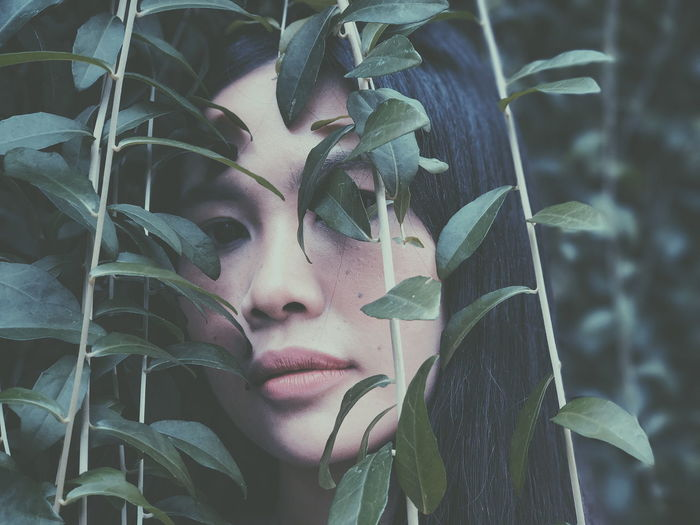 Close-Up Of Young Woman With Plants