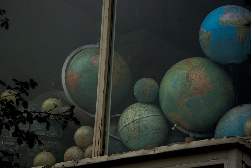 old globes behind window Dark, Day Globe Globes Map No People Old Maps Window