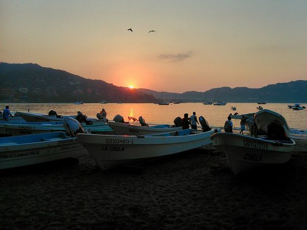 Sea Water Sand Beach Fishing Mountain Nature People Sunrise Sun Sunreflection Mexico Bird Seagulls Day Morning Hardwork Fisherman Zihuatanejo Boats Motorboats Culture Sky Colors EyeEmNewHere