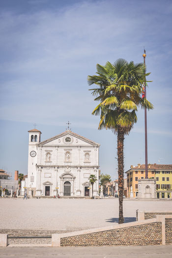 Italia Architecture Belief Building Building Exterior Built Structure City Day Incidental People Italy Nature Outdoors Palm Tree Palmanova Place Of Worship Plant Religion Sky Spirituality Tree Tropical Climate
