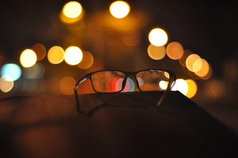 Close-up of illuminated lights on table