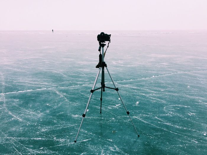 Tripod on frozen lake
