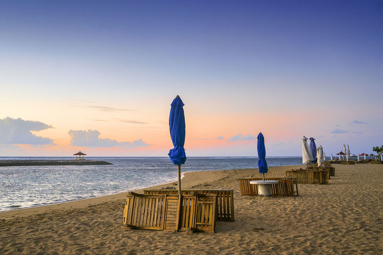 Karang beach Sanur, Bali, Indonesia in the morning ASIA Bali EyeEmNewHere Holiday INDONESIA Beach Beauty In Nature Day Horizon Over Water Nature No People Outdoors Restaurant Sand Sanur Beach Scenics Sea Shore Sky Sunset Tranquil Scene Tranquility Travel Destinations Vacation Water