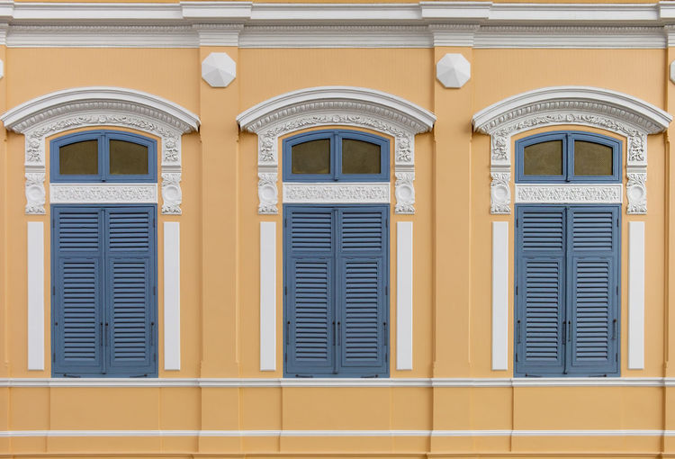 European Style Arch Window in Bangkok, Thailand. Architecture Building Building Exterior Built Structure City Closed Day Door Entrance Façade House Lighting Equipment No People Ornate Outdoors Pattern Residential District Safety Security Window Yellow