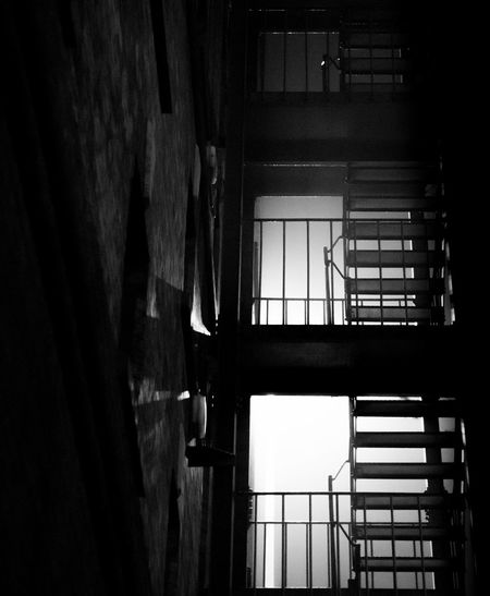 An eerily lit fire escape with the light diffused by a heavy fog EyeEmNewHere Somerset England Bristol Cityscape City Life City Night Lights Black And White Bnw Fire Escape Steps And Staircases Street Light Streetphotography Fog Nightphotography Night Window Indoors  Apartment The Graphic City EyeEmNewHere