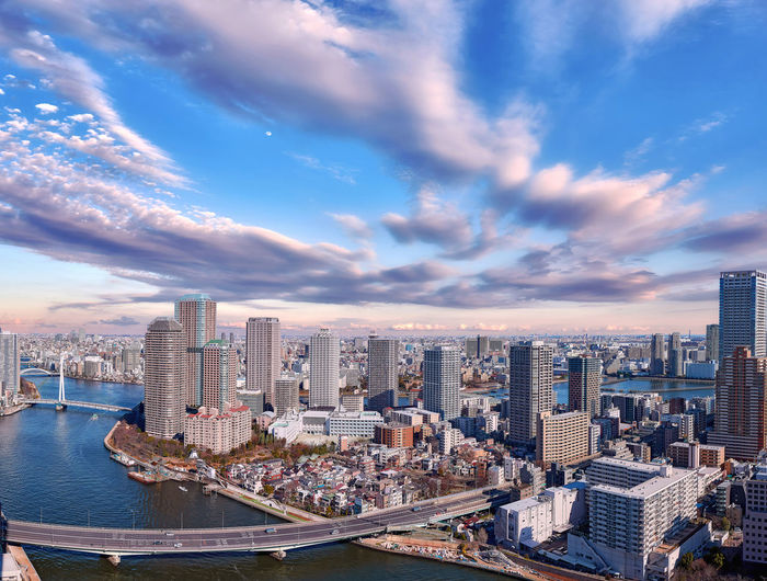 Wide angle aerial panorama of sumida river in tokyo under dramatic cloudy sky