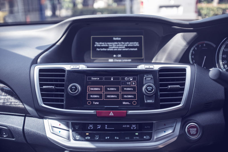 modern car dashboard with bokeh background, shallow depth of field, filter effect Automobile Button Caution Panel Air Condition Car Car Interior Console Control Control Panel Dashboard Design Interior Luxury Modern Monitor Navigation Safety Start System Technology Touch Screen Transportation Warning Windshield