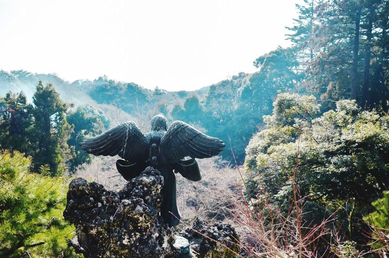 Angel Statue At Temple On Mountains Against Sky